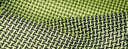 Black carbon fiber composite raw material close up background. Kevlar aramid Royalty Free Stock Photos