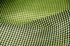 Black carbon fiber composite raw material close up background. Kevlar aramid Stock Photography