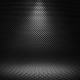 Black carbon fiber textured interior studio with directional lig. Modern black carbon fiber textured interior studio with directional light for background Stock Photo