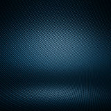 Black carbon fiber textured interior studio. Modern dark blue carbon fiber textured interior studio with light for background Stock Photography