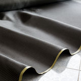 Black carbon fiber twill composite material background Stock Photography