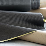 Black carbon fiber twill composite material background Royalty Free Stock Photos