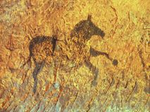 Black carbon paint of horse on sandstone wall Stock Photos
