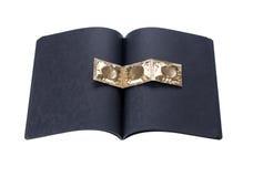Black cardboard notebook with golden condoms Stock Photo