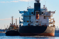 Black cargo ship. Entering the port of Riga, Europe royalty free stock photo