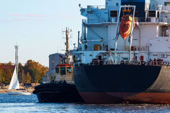 Black cargo ship. Entering the port of Riga, Europe royalty free stock images