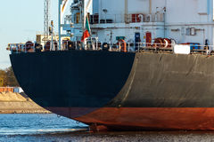 Black cargo ship. Entering the port of Riga, Europe royalty free stock image