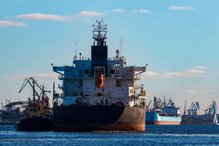 Black cargo ship. Entering the port of Riga, Europe royalty free stock photography