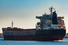 Black cargo ship entering Riga, Europe Stock Photography
