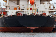 Black cargo ship. Loading in the port of Riga, Europe stock image