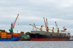 Black cargo ship. Loading in the port of Riga, Europe Royalty Free Stock Photos