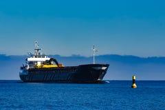 Black cargo ship Stock Photography