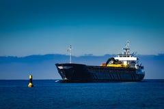 Black cargo ship Stock Photos