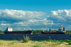 Black tanker ship. Black cargo tanker ship moving past the cargo port Stock Images