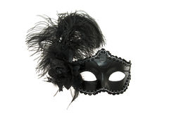 Black carnival or masquerade mask. Black carnival mask with a feather on a white background Stock Images