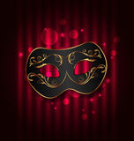 Black carnival ornate  mask on glowing background Royalty Free Stock Photo
