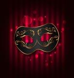 Black carnival ornate  mask on glowing background Royalty Free Stock Photo