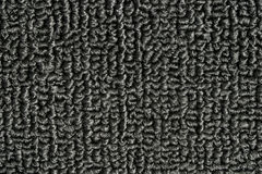 Black Carpet Texture. Photo of a gray black carpet for background, patterns, design elements or texture Royalty Free Stock Photo