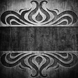 Black carved ornament on wooden texture. Wooden background with carved pattern Royalty Free Stock Photo