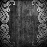 Black carved ornament on wooden texture Stock Images