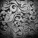 Black carved ornament on wooden texture Royalty Free Stock Image