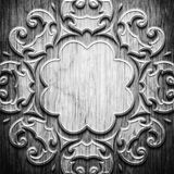 Black carved wooden pattern. Black carved ornament on wooden texture Stock Photos