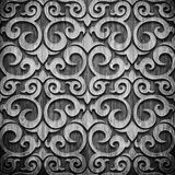 Black carved wooden pattern. Black carved ornament on wooden texture Royalty Free Stock Photo