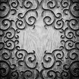 Black carved wooden pattern. Black carved ornament on wooden texture Royalty Free Stock Image