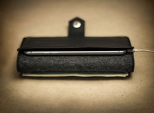 Black case for smartphone and money, open view, closeup Stock Photo