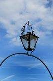 Black cast iron lamp with sky Stock Images