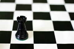 Black castle on chess board Royalty Free Stock Photography