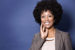 Black casual woman on blue background Stock Photo
