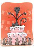 Black cat on a cake Royalty Free Stock Image