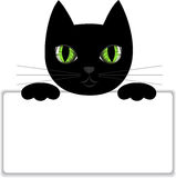 Black cat with a card. Black cat keeps paws white card Royalty Free Stock Photo