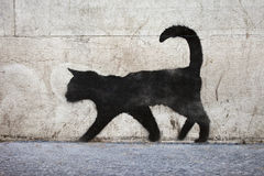 Black Cat Graffiti. Graffiti outline of a black cat in urban Paris stock photo