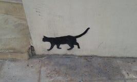 Black cat. Graffiti of black cat. Street art. Heraklion. Crete. Greece Royalty Free Stock Photo