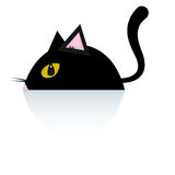 Black cat. A black cat is lying down on the floor Royalty Free Stock Photos