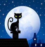 Black cat and moon. Black cat on chimney with moon town and starry night in the background Stock Photo