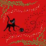 Black cat playing with ball of yarn Royalty Free Stock Images
