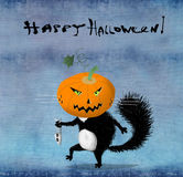 Black Cat with Pumpkin Head With Fish Bones. Funny Halloween Card: black cat with pumpkin head holding fish skeleton Stock Photo
