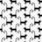 Black cat seamless pattern on polka dots background. Royalty Free Stock Image