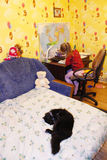 Black cat sleeping on the bed in children's room Stock Image