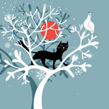 A black cat on the snow-covered tree Royalty Free Stock Photography