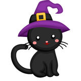 Black cat wearing a witch hat Royalty Free Stock Images