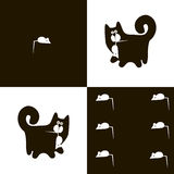 Black cat and white mouse 1x6. Agile black cat with a mouse Royalty Free Stock Images