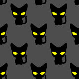 Black cat with yellow eyes at night seamless pattern. Vector bac Royalty Free Stock Image