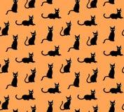 Black cats cute pattern vector on orange background royalty free illustration