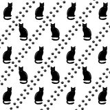 Black cats and footsteps. Vector illustration Stock Photos