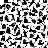 Black cats pattern. Vector Seamless pattern with cute black cats silhouette on white background Stock Photos