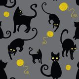 Black cats silhouettes seamless pattern. Hand drawn black cats silhouettes seamless pattern. Vector illustration of cats with wool cloths on grey background vector illustration